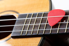 Small Hawaiian four stringed ukulele guitar Royalty Free Stock Photo