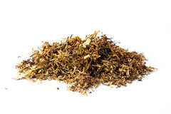 Small heap of loose tobacco, on a white background Stock Photo