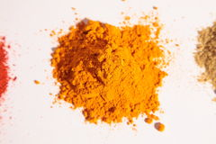 Small heap of spices, the turmeric powder Royalty Free Stock Images