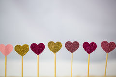Small hearts in a row, lights in the background Royalty Free Stock Image