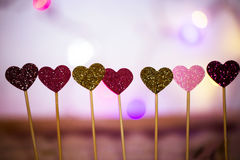 Small hearts in a row, lights in the background Royalty Free Stock Photography
