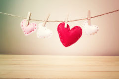 Small Hearts with Stitches Hanging on a String Stock Images