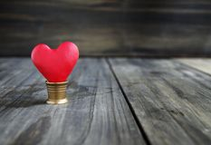 Small hearts on a wooden background Royalty Free Stock Photos