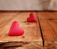 Small hearts on a wooden background Stock Images