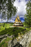 Small Heddal Stave Church. A view of the church in Heddal, his yard , the surounding wall and cementary Stock Photo