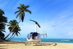 Small helicopter for excursions on a deserted beach. Dominican Republic royalty free stock photo