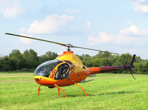 Small helicopter in grassy field. Royalty Free Stock Photos