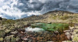Small high mountain lake Stock Image