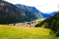 Small hihgland town in dolomites valley Stock Photos