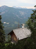 Small Hiking Rest House on Cliff Overhang with Mountain View. Small Hiking Rest House on Cliff Overhang with View of Forest Mountains Stock Photography