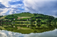 A small hill and a lake. Stock Image
