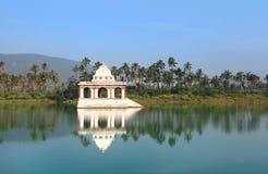 Small Hindu temple in Koneru lake Stock Photography