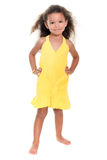 Small hispanic girl wearing a yellow summer dress Stock Photography