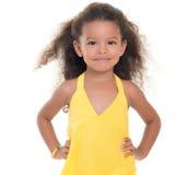 Small hispanic girl wearing a yellow summer dress Royalty Free Stock Photography