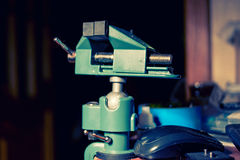 Small hobby DIY vise on table near computer Royalty Free Stock Photography