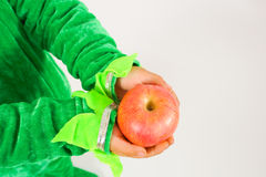 Small holding apple. Small hands with the Big Apple, dedicated to you, me, him Royalty Free Stock Photography