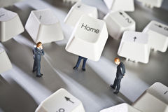 Small home based business. Business figurines placed with keys from a computer keyboard royalty free stock image