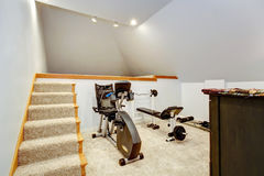 Small home gym area. Small home gym with two exercise equipments and stairs Stock Photos