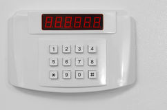 Small home or hotel wall safe. With keypad, closed door Stock Photo