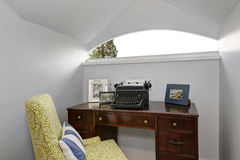 Small home office area with retro typing machine. Stock Photo