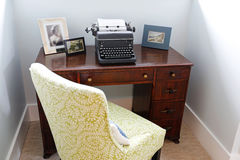 Small home office area with retro typing machine. Royalty Free Stock Images