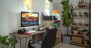Small homeoffice for photographer with plants decor and Bromo Mt picture on the destop wall paper