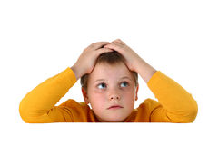 Small hopeless boy holding head with both hands Stock Images