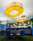Hotel bar with huge lamps Stock Images