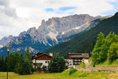 Small hotels by the road in Dolomites Stock Photos