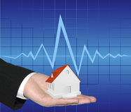 Small house. On business mans hand Royalty Free Stock Photo