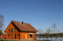 Small house. Traditional small wooden house near the river Stock Photos