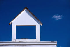 Small house. Small wooden house with blue sky Royalty Free Stock Photos