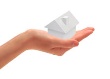 Small house. Female hand which holds a grey small house Stock Image