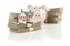 Small House And Piggy Bank With Stacks Money Royalty Free Stock Photo