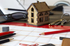 Small house in the background, and keys, stationery, desk kal Stock Image