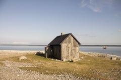 Small house on the beach Stock Photos