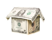 A small house built out of dollar bills Stock Images