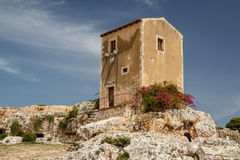Small house built on top the ancient Greek theatre in Syracuse Stock Images