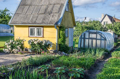 Small house close the greenhouse Royalty Free Stock Photo