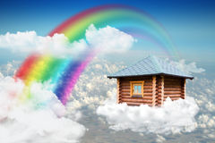 Small house on cloud in sky Royalty Free Stock Images