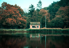 Small house at coast of the lake Royalty Free Stock Image