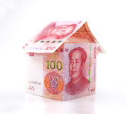 A small house constituted by banknotes Royalty Free Stock Photos