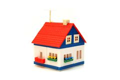 Small house constructed of toy blocks royalty free stock images
