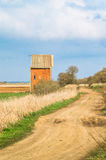 Small house by a countryside road Stock Image