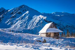 Small house covered with snow in the mountains Royalty Free Stock Photography