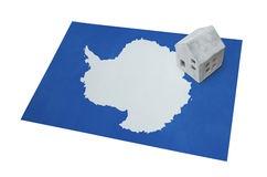 Small house on a flag - Antarctica Royalty Free Stock Photography