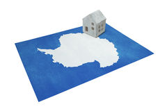 Small house on a flag - Antarctica Stock Photography