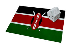 Small house on a flag - Kenya. Small house on a flag - Living or migrating to Kenya stock photo