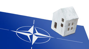 Small house on a flag - NATO. Small house on a flag - Flag of the NATO stock photos