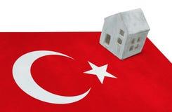 Small house on a flag - Turkey Stock Photo